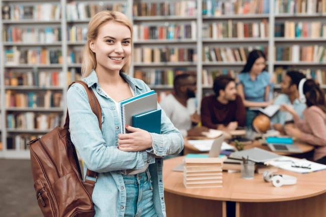 group-ethnic-multicultural-students-sitting-library_1x.jpg